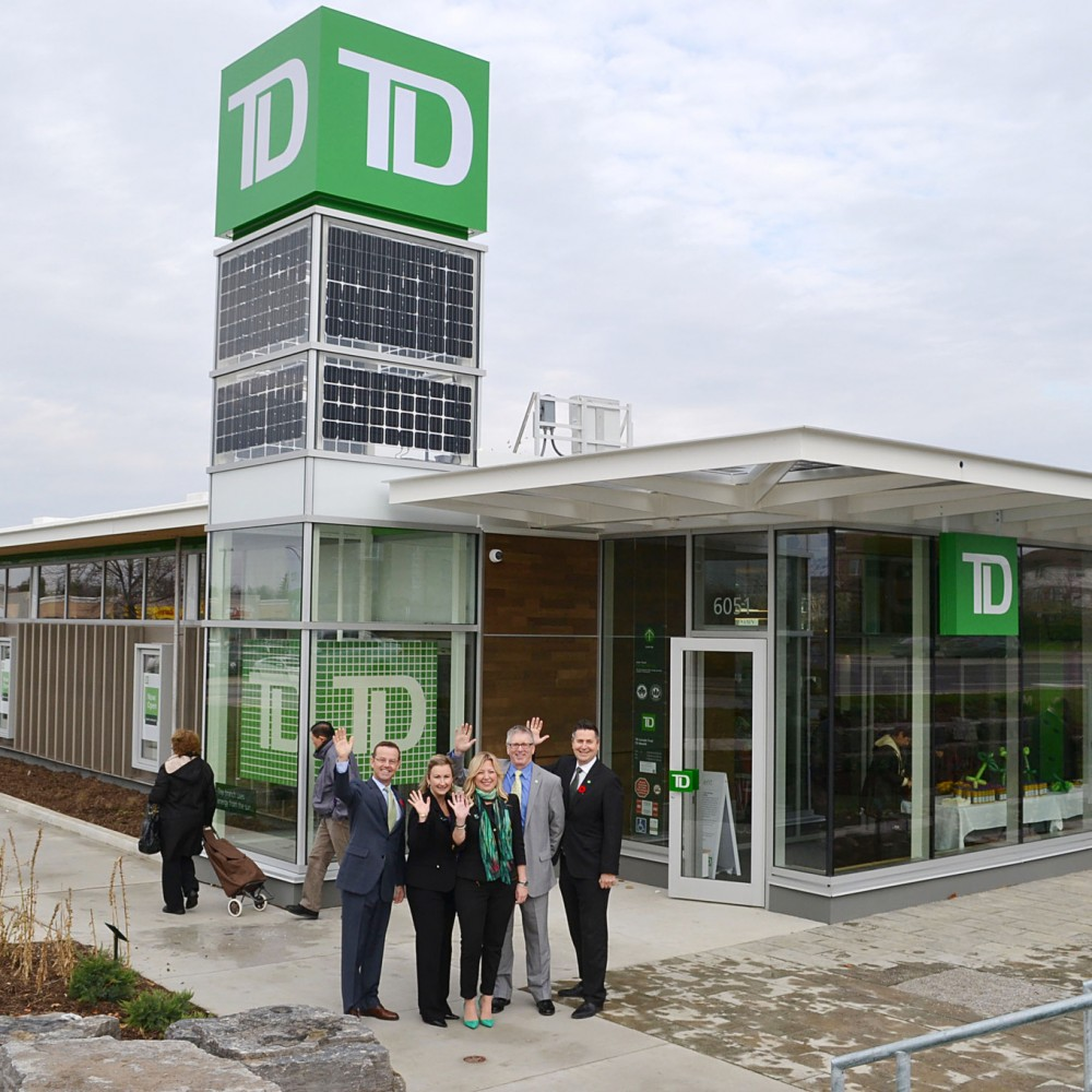 TD Canada Trust on Creditview Rd. officially opened their new green  concept branch today (Saturday, Nov. 9). From left, Tom Dyck, executive vice president of TD branch banking, branch manager Patricia Romeo, TD district vice president Rina DeGrazia, Ron McInnis, senior vice president of TD central Ontario region and James Popalis, vice president of Canadian Retail Real Estate pose outside the new digs.